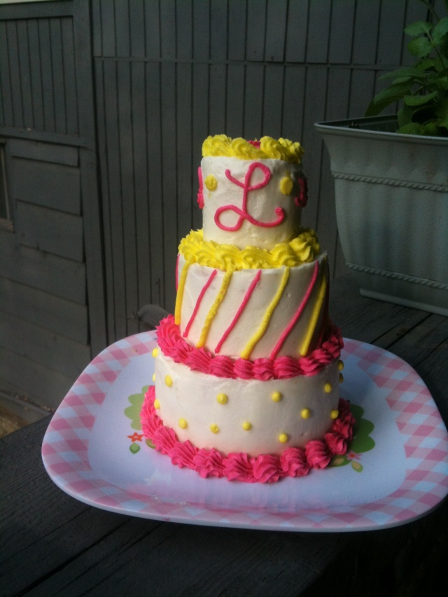 pink and yellow baby cake